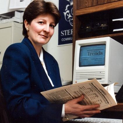 Barbara with her Mac SE computer